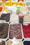 North African red and black spices in containers in a Paris, France market stock image