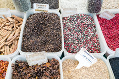 North African red and black spices in a Paris market with French signs royalty free stock photos