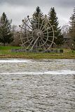 North America`s Largest Wooden Waterwheel In New Hamburg, Ontario. The historic Hartman Bridge over the Nith River in New Hamburg, Ontario, Canada in the royalty free stock photography