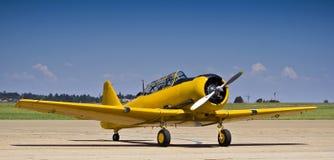 North American AT-6 Harvard. Vintage war plane - North American AT-6 Harvard, parked on the slipway Royalty Free Stock Image