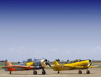North American AT-6 Harvards. A pair of vintage war planes - North American AT-6 Harvard's - sometimes referred to as SNJ3, parked on the slipway Stock Photography
