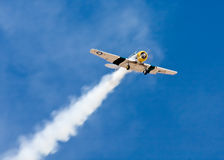 North American AT6 plane in air show. A historic North American AT-6 airplane is flying in the annual air show in El Cajon, California, Wings Over Gillespie Royalty Free Stock Photos