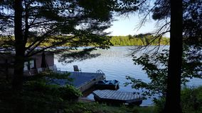 North American Cottage Dock in Summer royalty free stock images