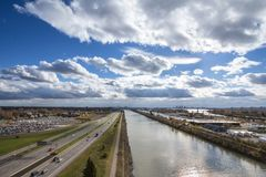 North American industrial landscape in Longueuil, in the suburb of Montreal, Quebec, Canada, with a large expressway, or autoroute. Picture of a motorway of royalty free stock photo