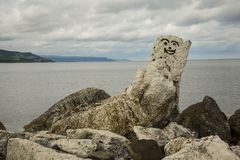 North Antrim Coast face on rock. Smiley face painted on lime stone rock at coast Stock Photography