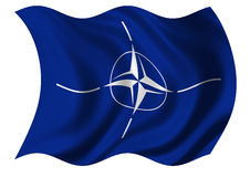 North Atlantic Treaty Organization (NATO) Flag. The North Atlantic Treaty Organization (NATO) flag on white background billowing in the wind Stock Image