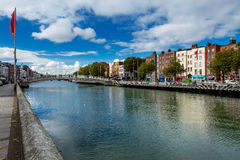North bank of the river Liffey with the pedestrian Liffey Bridge Royalty Free Stock Image