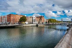 North bank of the river Liffey with the pedestrian Liffey Bridge Stock Images
