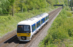 North bound commuter train. BEACOSNFIELD, UK - MAY 9: A Chiltern Railways operated DMU commuter service heads through rural Buckinghamshire towards Birmingham Royalty Free Stock Photography