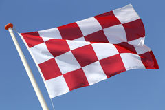 North Brabant. Flag of Dutch province North Brabant blowing in the wind royalty free stock image