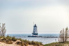 Lighthouse at Ludington, MI. North Breakwater Light on Lake Michigan with both blue and gray water along the pier royalty free stock image