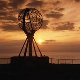 North cape globe midnightsun. North Cape, Norway at the northernmost point of Europe, located at 71°10′21″N 25°47′40″E, midnightsun in june Stock Image