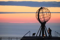The North Cape, with people and dogs royalty free stock image