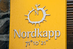 North Cape sign tablet. North Cape (Norwegian: Nordkapp; North Sami: Davvenjárga) is a cape on the island of Magerøya in Northern Norway, in the municipality Stock Photo