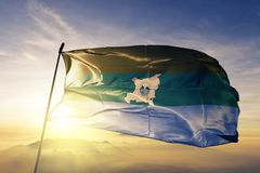 North Caribbean Coast Autonomous Region of Nicaragua flag textile cloth fabric waving on the top sunrise mist fog. Beautiful royalty free stock image