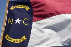 North Carolina Flag. Waving in the Wind Royalty Free Stock Photography