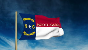 North carolina flag slider style with title. Waving with cloud background animation stock footage