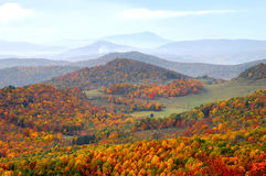 North Carolina Highlands and Grandfather Mountain. An autumn view of Grandfather Mountain in  Western North Carolina and the stunning fall foliage in the valley Royalty Free Stock Photo
