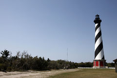 North Carolina lighthouse. Cape Hatteras Light is a lighthouse located on Hatteras Island in the Outer Banks of North Carolina near the community of Buxton, and Stock Photos
