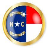 North Carolina  Flag Button. North Carolina  state flag button with a gold metal circular border over a white background Royalty Free Stock Photos