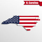 North Carolina State map with US flag inside and ribbon Royalty Free Stock Image