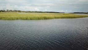 North Carolina Tidal Creek Marsh BHI Bald Head Island Marina stock footage