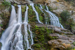 North Carolina, waterfall. Silky waters branch out over a moss covered rock face in the Blue Ridge Mountains of North Carolina Stock Photography