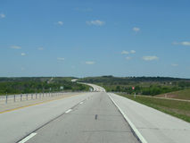 North central Oklahoma highway turnpike scenery. Oklahoma highways and scenery between Tulsa and the Kansas Border. Rolling hills in springtime on a four lane Stock Photography