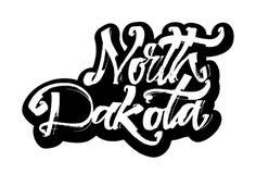 North Dakota etikett Modern kalligrafihandbokstäver för serigrafitryck Arkivbild