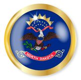 North Dakota Flag Button. North Dakota state flag button with a gold metal circular border over a white background Stock Images
