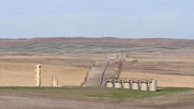 North Dakota Oil Well. A North Dakota Oil Well and a pipeline Royalty Free Stock Image