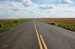 North Dakota ,rural road. Amazing condition of rural roads in North Dakota, very helpful and comfortable for farmers and visitors Royalty Free Stock Images