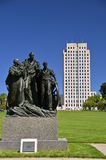 North Dakota State Capital Grounds. A view of the North Dakota capital building and grounds expose a statue honoring the early pioneers stock photos