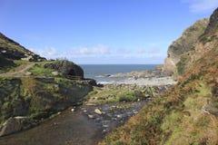 North Devon cliffs and beach. Rocky beach and cliffs North Devon England Coastline stock photo