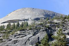 North dome and lower slopes viewed from Mirror lake, Yosemite National Park, California. Near Half Dome, lake a favorite spot to view clear images of slopes Stock Images