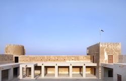 North Eastern galleries & towers of Zubarah fort, Qatar. The Zubarah Fort built in 1938 follows a traditional concept with a square ground plan with towers Royalty Free Stock Image