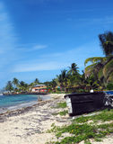 North End Beach Big Corn Island Nicaragua. With old boats and hotel in background on Caribbean Sea Stock Photography