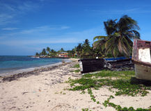 North End Beach Big Corn Island Nicaragua  old boats and hotel i. North End Beach Big Corn Island Nicaragua with old boats and hotel in background on Caribbean Royalty Free Stock Photos