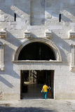 North entrance ( Golden gate ) of Diocletian palace, Split Croatia. Woman enters to Diocletian palace through the Golden gate, Split in Croatia Royalty Free Stock Photo