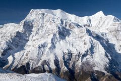 North face of Annapurna II and Annapurna IV, Annapurna Circuit, Manang, Nepal. View of north face of Annapurna II and Annapurna IV from Kicho Tal (Ice Lake) on Royalty Free Stock Image