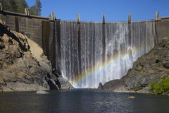 North Fork Dam with Rainbow. Beautiful North Fork Dam in CA with natural rainbow in the waterfall (American River Royalty Free Stock Images