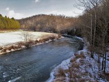 North Fork New River. The North Fork New River surrounded by snow covered banks and mountains near the town of Lansing, North Carolina Stock Photography
