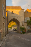 The north gate in the medieval village Noyers-sur-Serein. Sunset view of the north gate La Porte de Tonnerre, in the medieval village Noyers-sur-Serein, Burgundy Stock Image