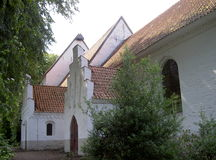 North German Church. Three nested houses provide a small North German church, whose style is influenced Danish Stock Photo