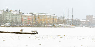 North Harbour is hardly visible through snow wall. Winter Helsinki Royalty Free Stock Photos