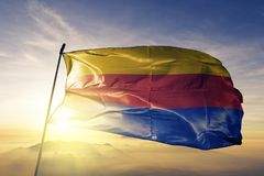 North Holland Province of Netherlands flag textile cloth fabric waving on the top sunrise mist fog. Beautiful stock image