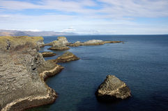 North of Iceland. Rocky coast on North seashore of Iceland Royalty Free Stock Photo