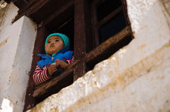 North India little girl. Looking out at the window Royalty Free Stock Photo