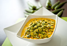 North Indian Dish of Okra. Okra/Lady finger in a curry of curd Stock Photo