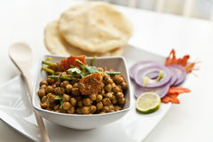 North Indian Dish. North indian spicy meal of chickpeas Stock Photos